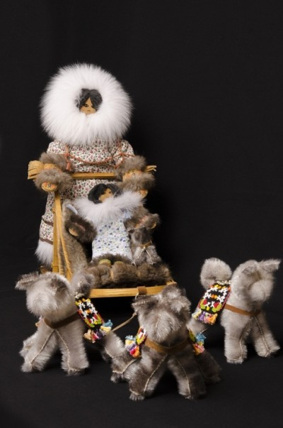"Juk Juk; by Lena White, leatherwork, woodwork, beadwork, wood, sinew, hardware, cotton material, stroud, beads, embroidery thread, sealskin, muskrat, blue fox, arctic fox, home tan moose hide, thread, stuffing, miniature bells and yarn, 18.5"" x 41"" x 16"""