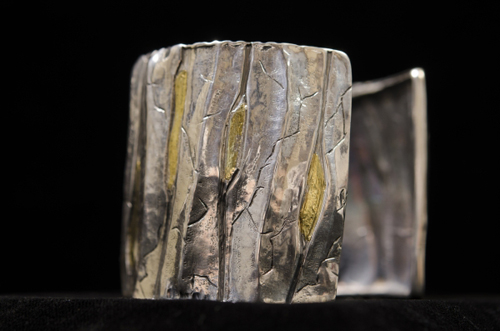 Yukon Permanent Art Collection 2016, Tourism and Culture, Arts Branch Artist: Cheryl Rivest Title: Miles Canyon Bracelet Genre: Fine Craft Year: 2015 List of Materials: Sterling Silver & Yukon Placer Gold from Davidson Creek, Mayo Dimensions: 18cm x 5cm
