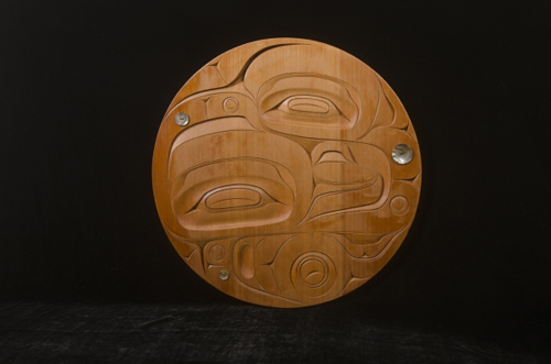 "Yukon Permanent Art Collection 2016, Tourism and Culture, Arts Branch Artist: Blake Lepine Title: The Ever Evolving Spirit Genre: Carving Year: 2015 List of Materials: Red cedar, abalone buttons, moose sinew Dimensions: 20"" x 20"" x 1.75"""