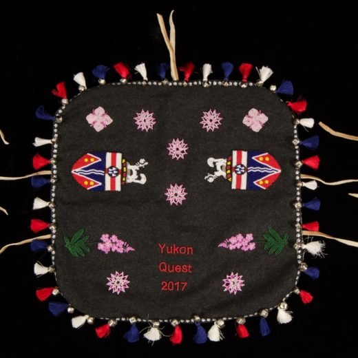 Yukon Permanent Art Collection 2017, Tourism and Culture, Arts Branch Artist: Deb Enoch Title: Traditionhal First Nations Dog Blanket Project Year: 2017 Materials: Melton, canvas backing, grosgrain ribbon, silk tassels, silver bells, seed beads