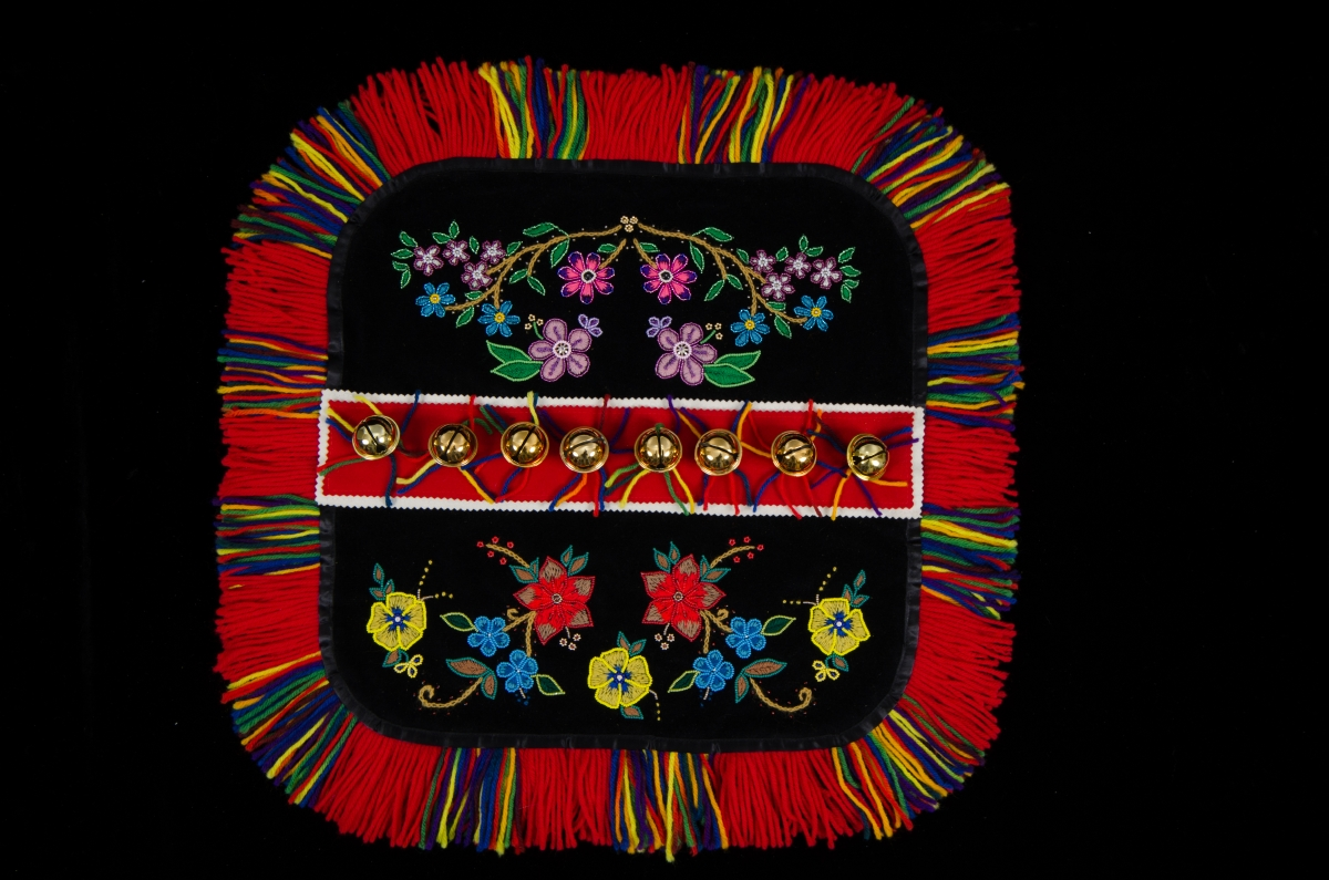 Yukon Permanent Art Collection 2017, Tourism and Culture, Arts Branch Artist: Diane Olsen Title: Traditionhal First Nations Dog Blanket Project Year: 2017 Materials: Velveteen and Melton, canvas backing, satin ribbon, wool yarn, gold-tone bells, embroidery  floss, seed beads