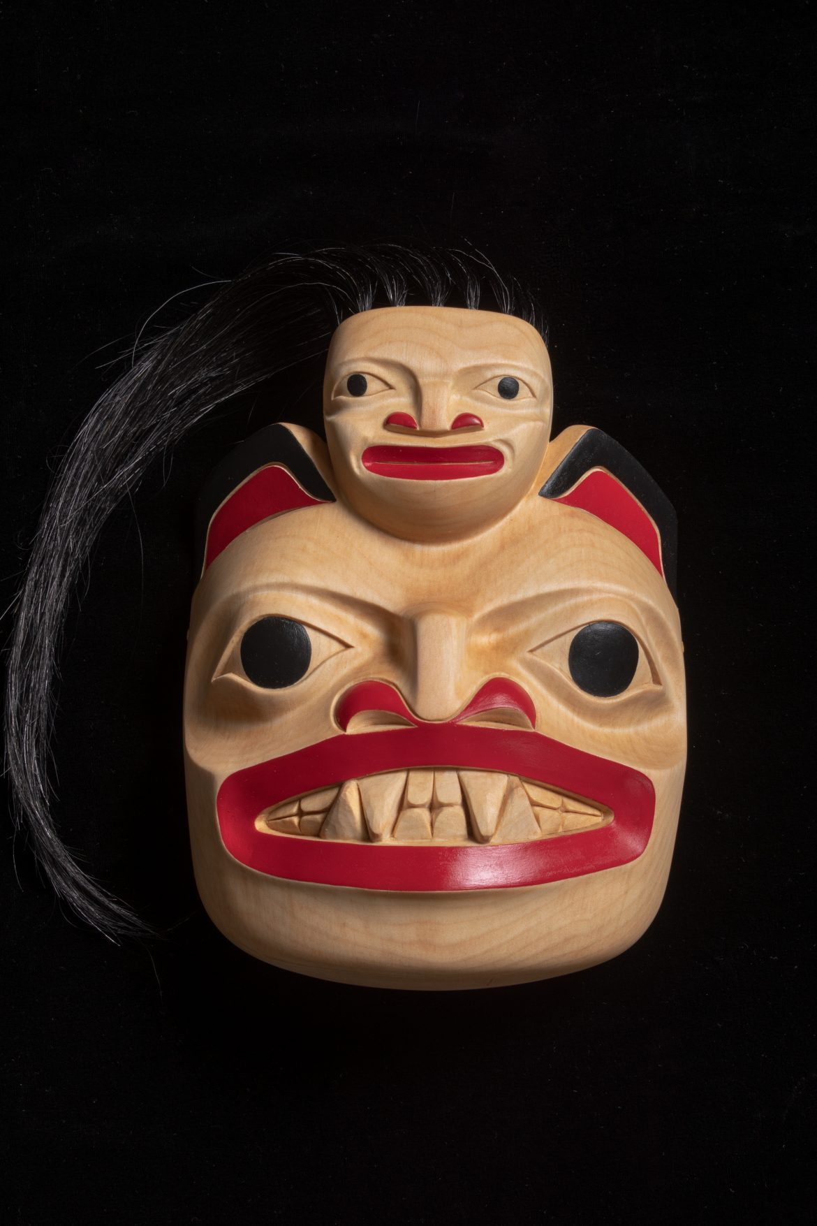 Cedar carving artwork by Yukon Artist Lorraine M Wolfe