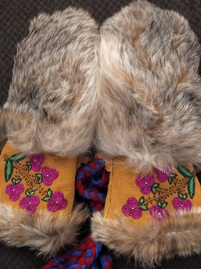 Fireweed Mitts made of tanned hide, lynx fur, and beads by Yukon artist Audrey Brown
