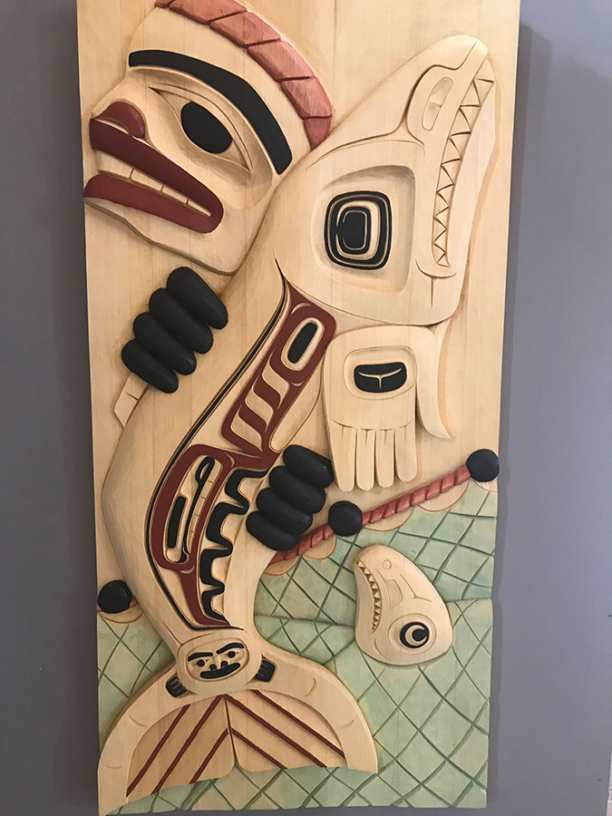 Pulling in the Net is a carving in yellow cedar by Yukon artist Violet Gatensby. Part of the Yukon Permanent Art Collection.