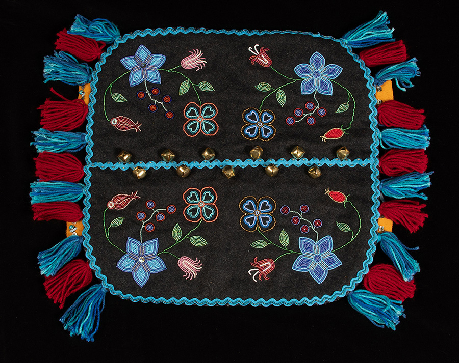 Melton cloth, canvas backing, bells, seed beads, wool yarn artwork by Yukon artist Anne Tayler. Part of the Yukon Permanent Art Collection