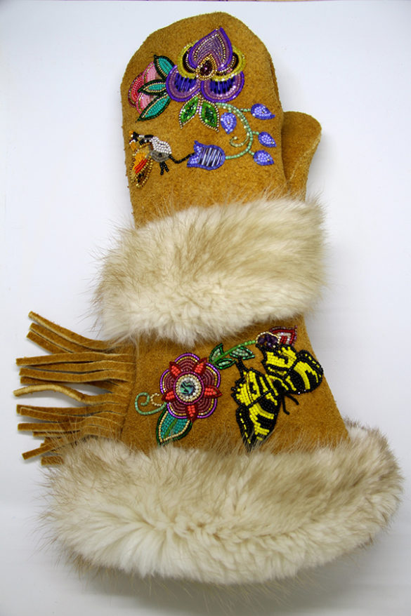 Made of tanned moose hide, porcupine quills, and fur by Yukon artist Vashti Etzel. Part of the Yukon Permanent Art Collection.